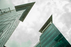 Glass building and  two towers Royalty Free Stock Image