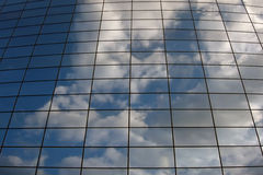 Glass building wall in the clouds Royalty Free Stock Images