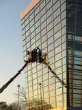 Glass Building Window Washers Cherry Picker Royalty Free Stock Photo