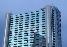 Glass Building With Balconies At Twilight Stock Image