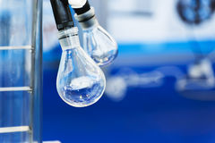 Glass bulb on a rotary laboratory evaporator. Industrial background. Shallow depth of field Stock Photography
