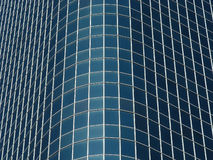 Glass Bulge. Rounded edge of a skyscraper looks almost like a bulge in the glass royalty free stock images