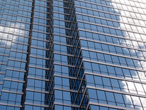 Glass Buliding in the clouds. Beautiful reflections of the clouds in the glass bulidings of downtown Dallas Royalty Free Stock Image