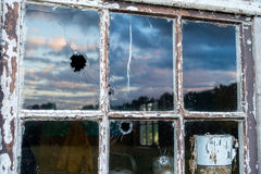 Glass bulletholes Stock Photography