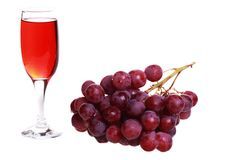 A glass and a bunch of grapes. Royalty Free Stock Photos