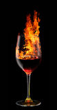 Glass of burning red wine Stock Photos