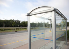 Glass bus stop Royalty Free Stock Images