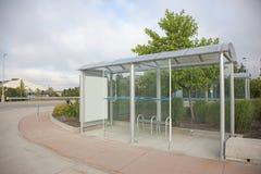 A  glass bus stop Royalty Free Stock Photos