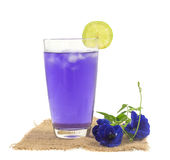 Glass of butterfly pea flower juice on white background Stock Photos