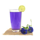 Glass of butterfly pea flower juice on white background Stock Photography