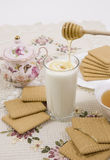 Glass of buttermilk and cookies. Glass of buttermilk (milk) and cookies with honey Royalty Free Stock Photos