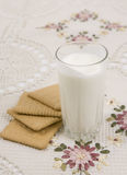 Glass of buttermilk and cookies. Glass of  buttermilk (yogurt) and cookies on a beautiful cloths Stock Images