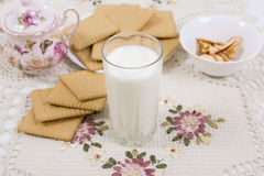 Glass of buttermilk (milk) and cookies. Glass of milk and cookies on a beautiful cloths Stock Photo