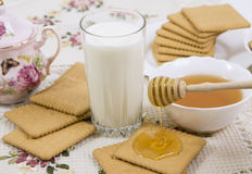 Glass of buttermilk (milk) and cookies Stock Photos
