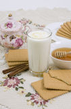 Glass of buttermilk (milk) and cookies with honey. Glass of milk and cookies on a beautiful cloths Royalty Free Stock Photos