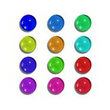 Glass Buttons. 12 glass buttons of different colours Stock Photography