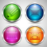 Glass buttons in metal frame with communication icons. Set of colored glass buttons in metal frame with communication icons Stock Photo