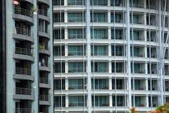 Glass byggnad med balkongen Arkivbild