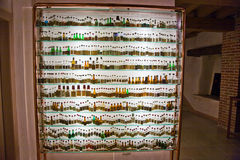 Glass Cabinet with historic bottles of Grappa in a Museum in Basano del Grappa, Italy Royalty Free Stock Photography