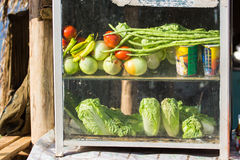 Glass cabinet with vegetable Stock Photo
