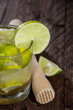 Glass with Caipirinha on wood Royalty Free Stock Image