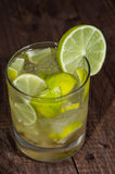 Glass with Caipirinha on wood Stock Image