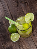 Glass with Caipirinha on wood Stock Photo