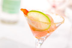 Glass of caipiroska with ice cream, strawberry and lime slice Royalty Free Stock Photos
