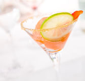 Glass of caipiroska with ice cream, strawberry and lime slice Stock Photo