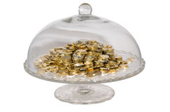 Glass cake stand with coins Stock Photos