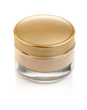Glass can with cream and gold lid Royalty Free Stock Photos