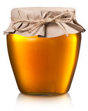 Glass can full of honey. Stock Images