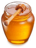Glass can full of honey. Clipping paths. Stock Photos