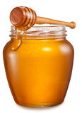 Glass can full of honey and wooden stick on it. Royalty Free Stock Photo