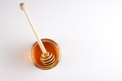 Glass can full of honey and wooden stick in it. top view Stock Photo