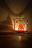 Glass candle with Christmas tree.  royalty free stock images