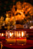 Glass candle of good luck Stock Images