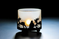 Glass candle holder with burning candle Stock Image