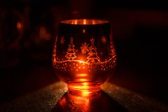 Glass candle holder with Christmas Christmas graphics in the form of the glass. stock photo
