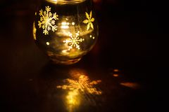 Glass candle holder with Christmas Christmas graphics in the form of the glass. royalty free stock photos