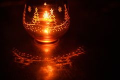 Free Glass Candle Holder With Christmas Christmas Graphics In The Form Of The Glass. Stock Photo - 129460790