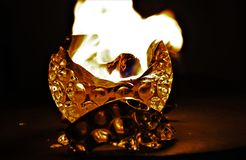 Glass candleholder wih growing flame in darkness royalty free stock photos