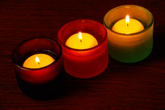 Glass candlesticks. Selective focus on the right candle Royalty Free Stock Photos