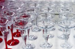 Glass candlesticks transparent and with a red leg on the shop window.  royalty free stock images