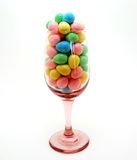 Glass of Candy. Wine glass filled with pastel colored candies Royalty Free Stock Photo