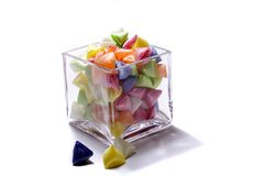 Glass Candy Dish and Sweets. Colorful hard candy in a square glass candy dish Stock Photo