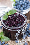 Glass with canned Blueberries. And some fresh fruits Royalty Free Stock Image