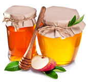 Glass cans full of honey and apple. Royalty Free Stock Photo