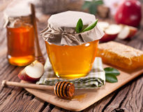 Glass cans full of honey, apples honeycombs. Stock Image