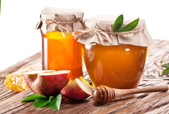 Glass cans full of honey and apples. Stock Image